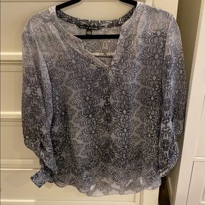 Black and grey blouse.